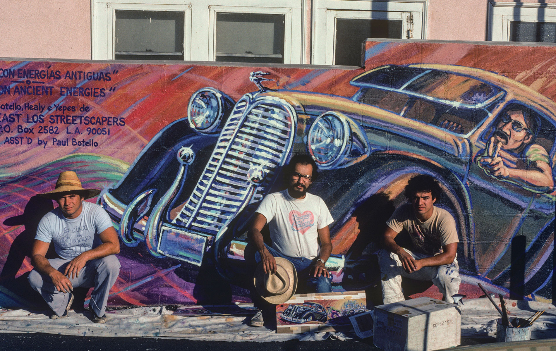 <h1>East Los Streetscapers Wayne Healy, David Botello, and George Yepes (<em>left to right</em>) complete <em>Filling Up on Ancient Energies</em>, 1980</h1>