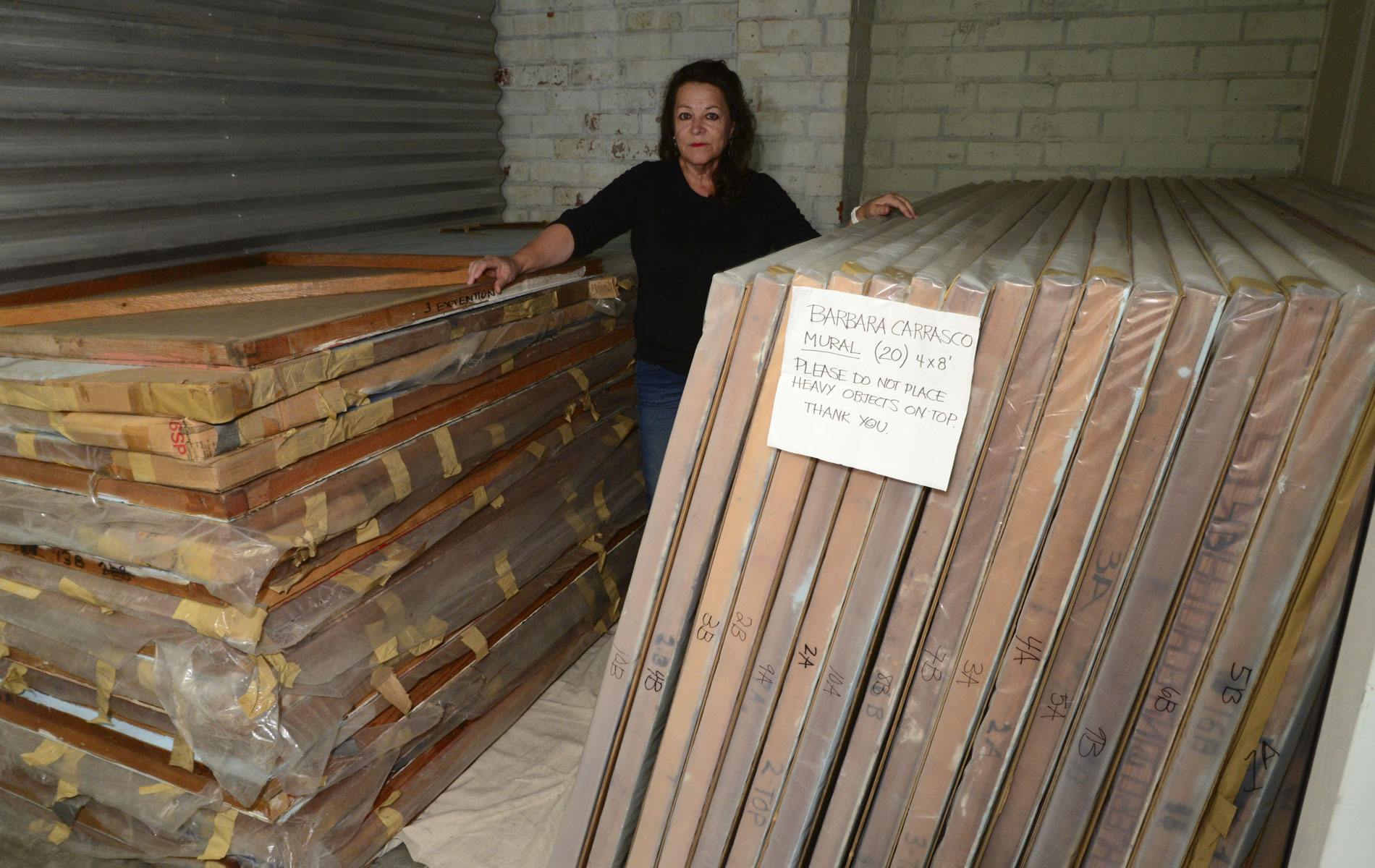 <h1>Barbara Carrasco with panels of <em>L.A. History</em> in storage, 2016</h1>