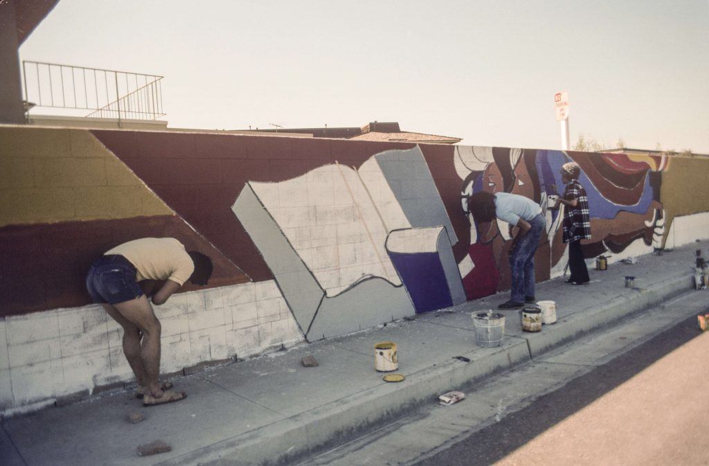 Colonia Juarez community members help paint Fountain Valley Mural, c. 1974–1976. Courtesy of the O'Cadiz Family Private Collection.
