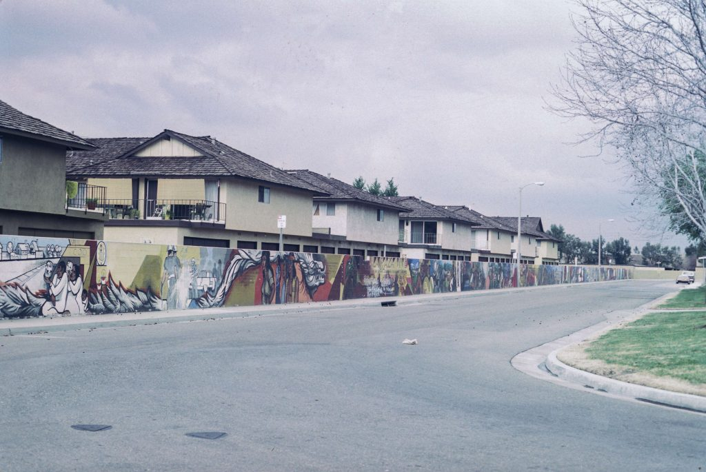 The completed Fountain Valley Mural along the Calle Zaragoza wall, c. 1976. Courtesy of the O'Cadiz Family Private Collection.