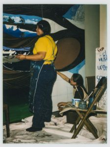Artist Yreina Cervantez paints a section of L.A. History, 1981. Courtesy of Barbara Carrasco.
