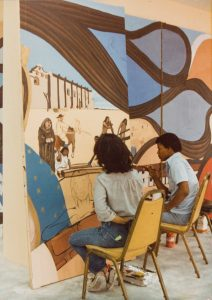 Youth workers paint sections of L.A. History, 1981. Courtesy of Barbara Carrasco.
