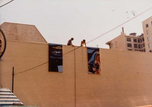 Two panels of Carrasco's mural are tested in their intended location near Grand Central Market, 1981. Courtesy of Barbara Carrasco